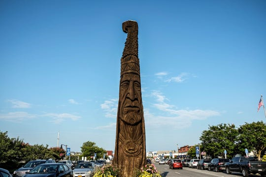 "A wooden statue, commonly known as the Bethany Beach ""totem pole,"" stands 24-feet tall on a median strip off  Del. 1 on Tuesday, July 30, 2019."