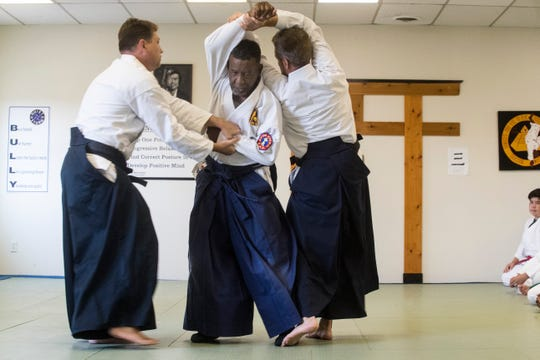 Sensei Rick Berry gives a demonstration of various Aikido movements and throws to a class Monday at Quiet Storm Dojo in Wilmington. Berry will be turning 80 this November.