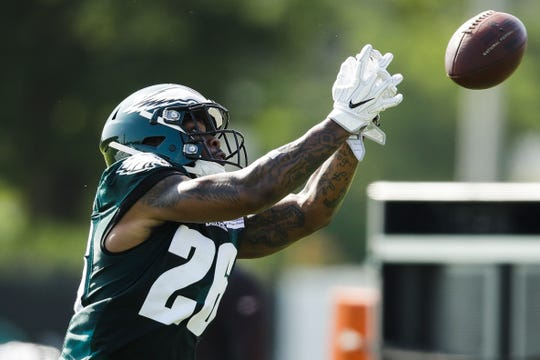 Eagles running back Miles Sanders works on a receiving drill during a recent practice.