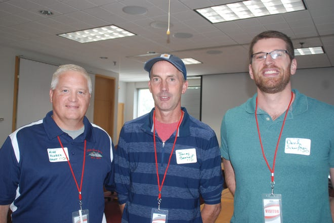 Mike Hlubeck, general manager at Chalet Cheese Co-op in Monroe (left) James Baerwolf co-owner of Sassy Cow (center), and David Scharfman of Specialty Cheese Company in Reeseville appeared at a Dairy Exchange meeting in Madison to talk about new dairy products they are introducing.