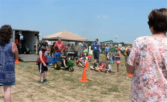 Kids tractor pedaling contest always draws a crowd.