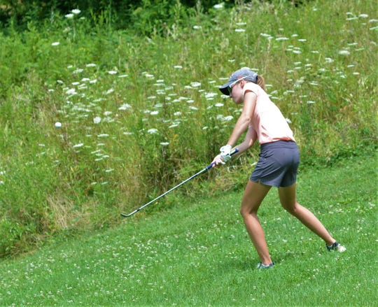 Alyssa Newsom chips on the par-3 17th hole during Tuesday's ZDGA Junior Amateur at par-70 EagleSticks. Newsom won the girls championship flight by six strokes.