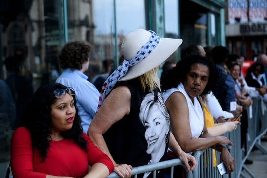 A woman wears a Hillary Clinton dress while waiting with others for the second 2020 Democratic debate at Fox Theater on July 30, 2019, in Detroit, Mich.