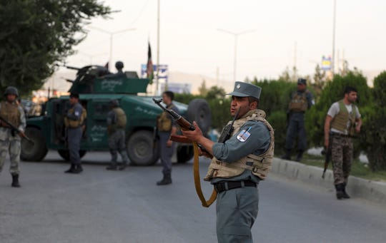 Afghan security personnel secure the site of an attack in Kabul, Afghanistan, Sunday, July 28, 2019.