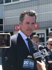 California Governor Gavin Newsom speaking at a news conference in front of Santa Clara Valley Medical Center in San Jose, California. The governor spoke on the shooting at the Gilroy Garlic Festival on Sunday, July 28, 2019.