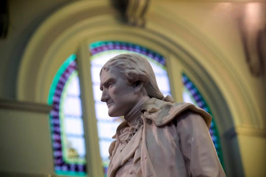 This Feb. 17, 2016 file photo shows statue of Thomas Jefferson greeting visitors in the main lobby of the Jefferson Hotel in Richmond, Va.