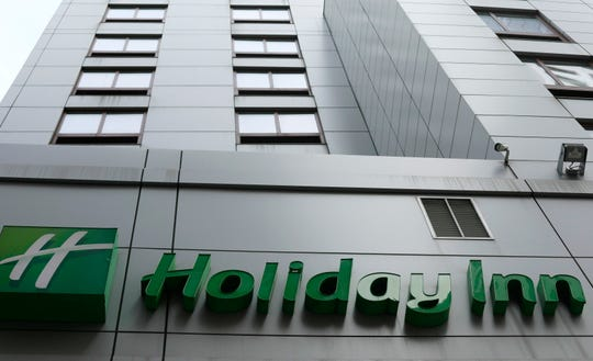 In this file photo dated March 28, 2019, the sign for a Holiday Inn in New York.