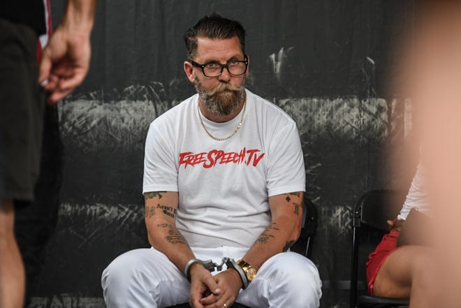 "Gavin Mcinnes wears fake handcuffs backstage during a ""Demand Free Speech"" rally on Freedom Plaza on July 6, 2019 in Washington, DC."