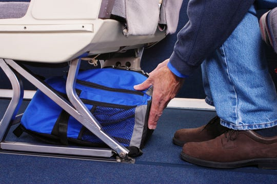You'd be surprised by how much you can fit under a seat, especially if you choose the right bag.