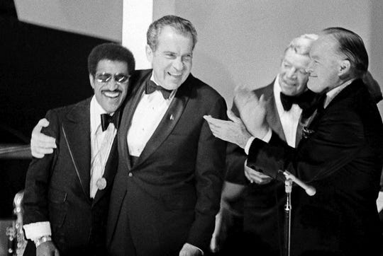 In this May 25, 1973, file photo, President Richard Nixon embraces Sammy Davis Jr. during festivities at the White House where about 450 former prisoners of war and their guests attended the affair in Washington.
