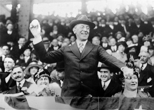 In this 1916 file photo, President Woodrow Wilson throws out the first ball at a baseball game in Washington.