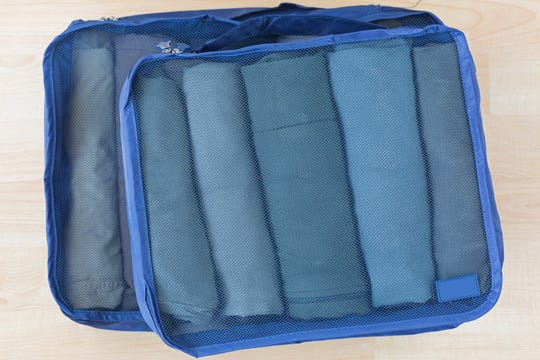 Mesh packing cubes can consolidate your clothes enough to get your electronics and other big necessities into the same carry-on bag.