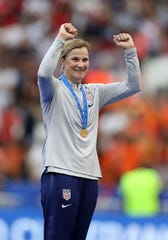 Jill Ellis celebrates after winning the World Cup in France.