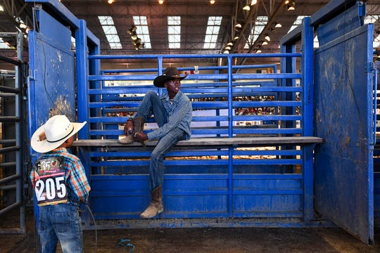 Kid competitors relax backstage before the 35th annual Bill Pickett Rodeo, July 20, 2019.