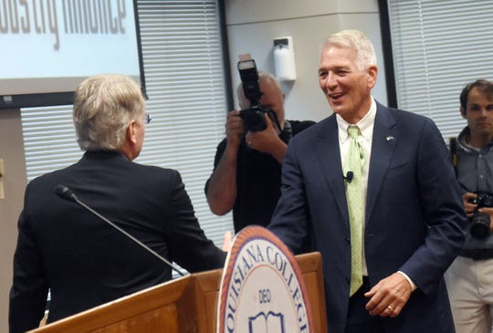 U.S. Rep. Ralph Abraham, right, is introduced as the guest speaker at the luncheon for the North Rapides Business and Industry Alliance held Wednesday, July 31, 2019 at Louisiana College.