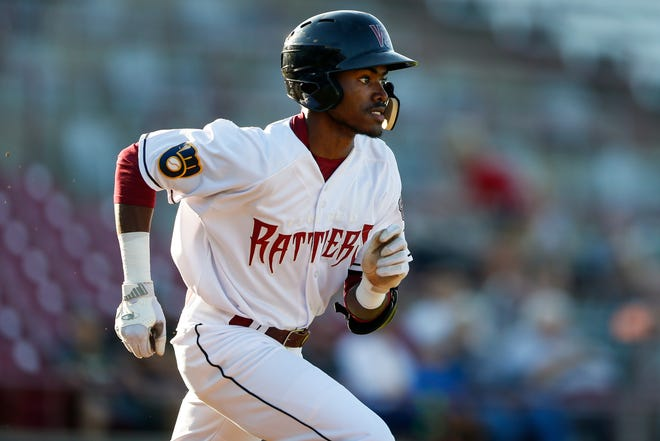 Korry Howell of the Wisconsin Timber Rattlers runs to first base during a game against the Clinton LumberKings on Tuesday at Neuroscience Group Field at Fox Cities Stadium in Grand Chute.