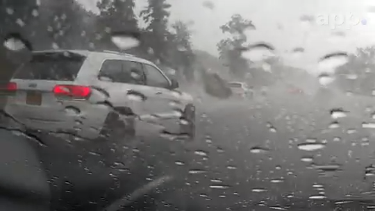 Dash cam video captures the line between heavy rain and sunshine on the Garden State Parkway southbound at the Wall and Brick border.