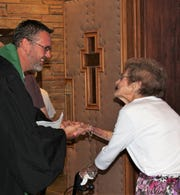 The Rev. Dustin Wilhite, the new pastor of Aldersgate UMC, greets a congregation member following his first service at the south-side Abilene church. He came to Abilene from Alamogordo, N.M.