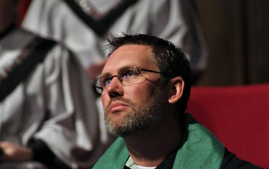 The Rev. Dustin Wilhite in a contemplative moment during his first service at Aldersgate UMC.