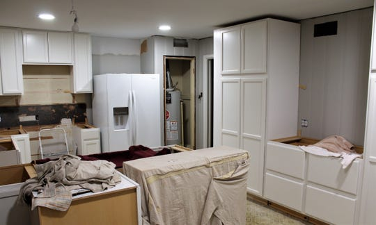 The tall cabinets that rise to within a couple of inches of the ceiling were a booger to get into the kitchen, much less set upright.
