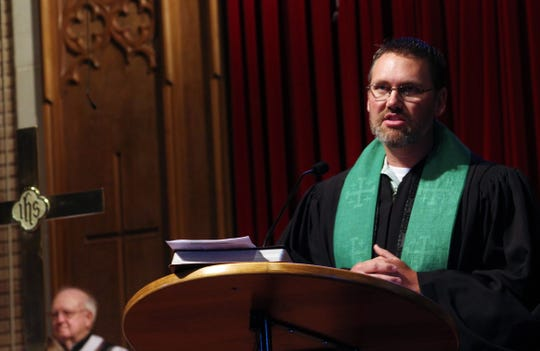 """The Rev. Dustin Wilhite seems to prefer preaching from the pulpit, and he has told his congregations that he thrives on their feedback, such as """"amens"""" when he makes a point."""