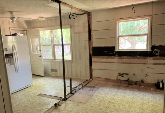 This what a kitchen looks like with nothing but a refrigerator in it. We're going to miss that '70s linoleum ... NOT!