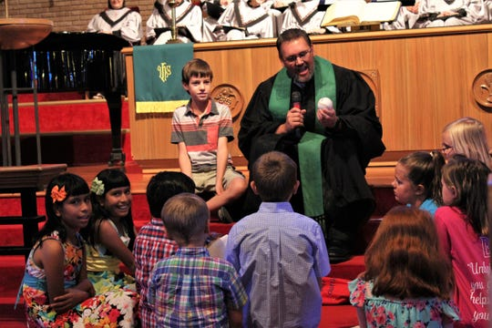 """The one thing he feared, the Rev. Dustin Wilhite said during his first service at Aldersgate UMC, was leading the """"stump the preacher"""" lesson with children. He hit a home run, however, with his first one by offering a lesson based on what's inside of the baseball he pulled from the mystery bag."""
