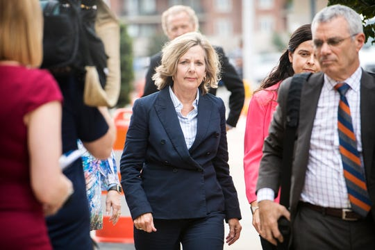 Former Buncombe County Commissioner Ellen Frost approaches the Charles R. Jonas Federal Building with her attorney, Tony Scheer, for her first court appearance since being indicted on federal fraud and conspiracy charges on July 31, 2019 in Charlotte. Frost plead not guilty to the charges and Scheer says they intend to take the case to trial.