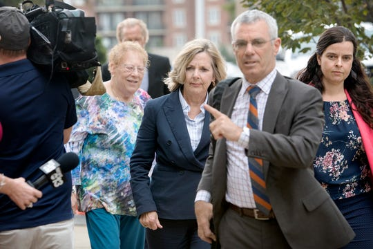 Former Buncombe County Commissioner Ellen Frost approaches the Charles R. Jonas Federal Building with her attorney, Tony Scheer, and daughter, Liz, for her first court appearance since being indicted on federal fraud and conspiracy charges on July 31, 2019 in Charlotte. Frost plead not guilty to the charges and Scheer says they intend to take the case to trial.