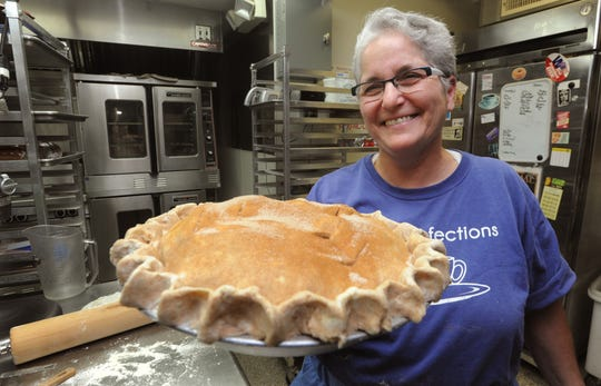 Carole Miller makes an apple pie at True Confections in the Grove Arcade in 2011.