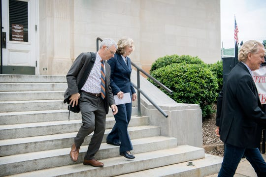 Former Buncombe County Commissioner Ellen Frost exits the Charles R. Jonas Federal Building with her attorney, Tony Scheer, after her first court appearance since being indicted on federal fraud and conspiracy charges on July 31, 2019 in Charlotte. Frost plead not guilty to the charges and Scheer says they intend to take the case to trial.