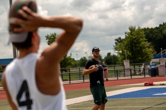 Former NFL QB and Marshall High School alumnus Ryan Van Dyke gives personal quarterback training to Pennfield junior Ryne Petersen on Wednesday, July 31, 2019 at Harper Creek High School.