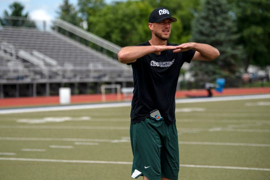 Ryan Van Dyke tells Pennfield junior Ryne Petersen to keep his shoulders level on Wednesday, July 31, 2019 at Harper Creek High School. Van Dyke, a former NFL QB and Marshall High School alumnus, is offering personal quarterback training for high school athletes.