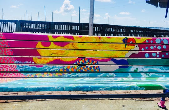 Jennifer Gallo's mermaid bench features  a vibrant array of colors, and is located in the kid's splash zone in Riverfront Park