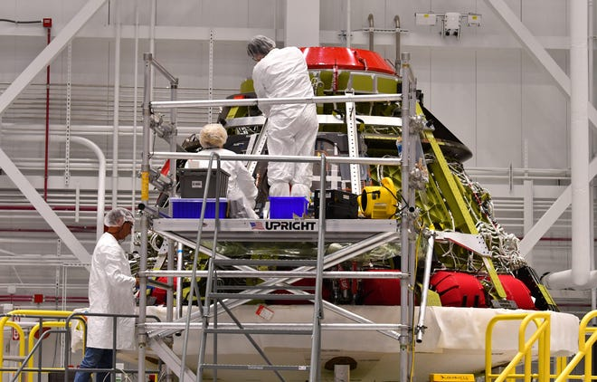 Inside the Boeing facility at Kenned Space Center, engineers and technicians prepared the Starliner service module for a test flight.
