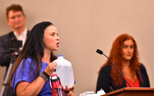 Nancy Kirby holds up a sample of the water at her home. She had her water tested, as did two of her neighbors, they all tested positive for Chloriform. She states her water just smells. It was a packed city council chamber with 219 people in the meeting and people waiting to get in for the meeting on the water quality of Melbourne's drinking water.