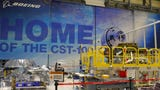 Work continues at Kennedy Space Center on Boeing Starliner capsule that will carry a mannequin wearing a spacesuit on an upcoming test flight