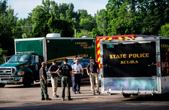 State Police, Colchester Police and Technical Rescue wait for instructions to continue searching for a missing kayaker in Colchester, VT, July 31, 2019.
