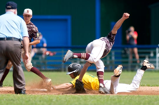 S.D. Ireland's Tyler Skaflestad, bottom, slides under the tag to steal second base during the 2019 American Legion baseball state championship in Colchester on Wednesday, July 31.