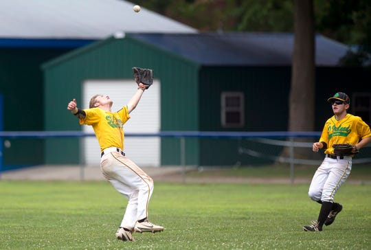 S.D. Ireland's Tyler Skaflestad, left, lays out to catch a fly ball during the 2019 American Legion baseball state championship in Colchester on Wednesday, July 31.