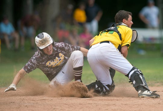 Brattleboro Post 5's Jack Pattison scores against S.D. Ireland catcher Jacob Murphy during the 2019 American Legion baseball state championship in Colchester on Wednesday, July 31.