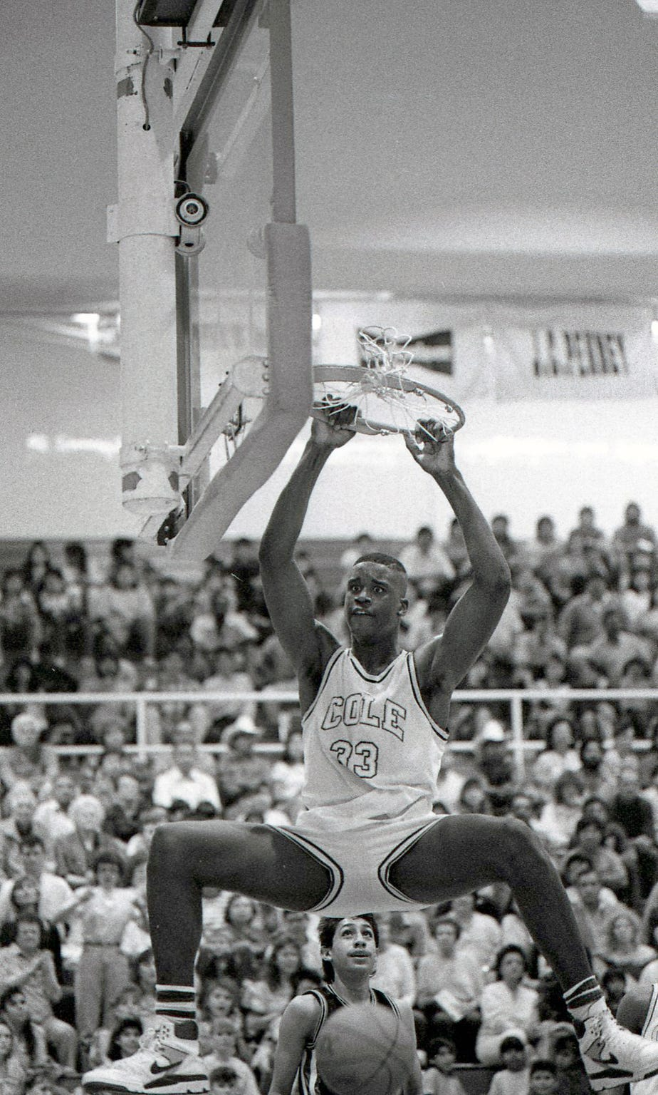West Oso's Julio Gonzalez could only look up to San Antonio Cole's Shaquille O'Neal (33) during the Region IV-3A tournament on March 3, 1989 at Steinke Event Center at Texas A&I University in Kingsville. San Antonio Cole won 80-53.