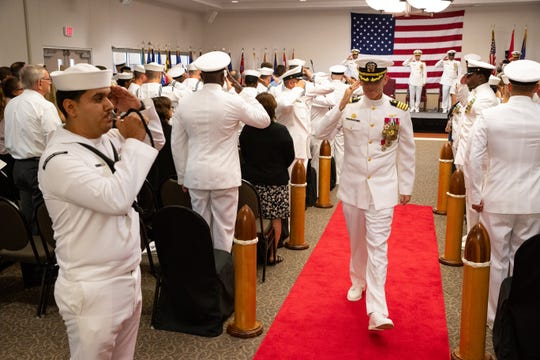 Outgoing commanding officer Capt. Philip Brock salutes as he leaves at the end of the Naval Air Station Corpus Christi change of command and retirement ceremony on Wednesday, July 31, 2019.