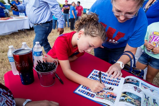 Sophia Baker, left, 8, and Kory Baker sign a yearbook during the groundbreaking for the new Gregory-Portland Middle School on Wednesday, July 31, 2019. Sophia will go to the new middle school. Her mom is a teacher at the current middle school and plans to teach at the new school when it opens.