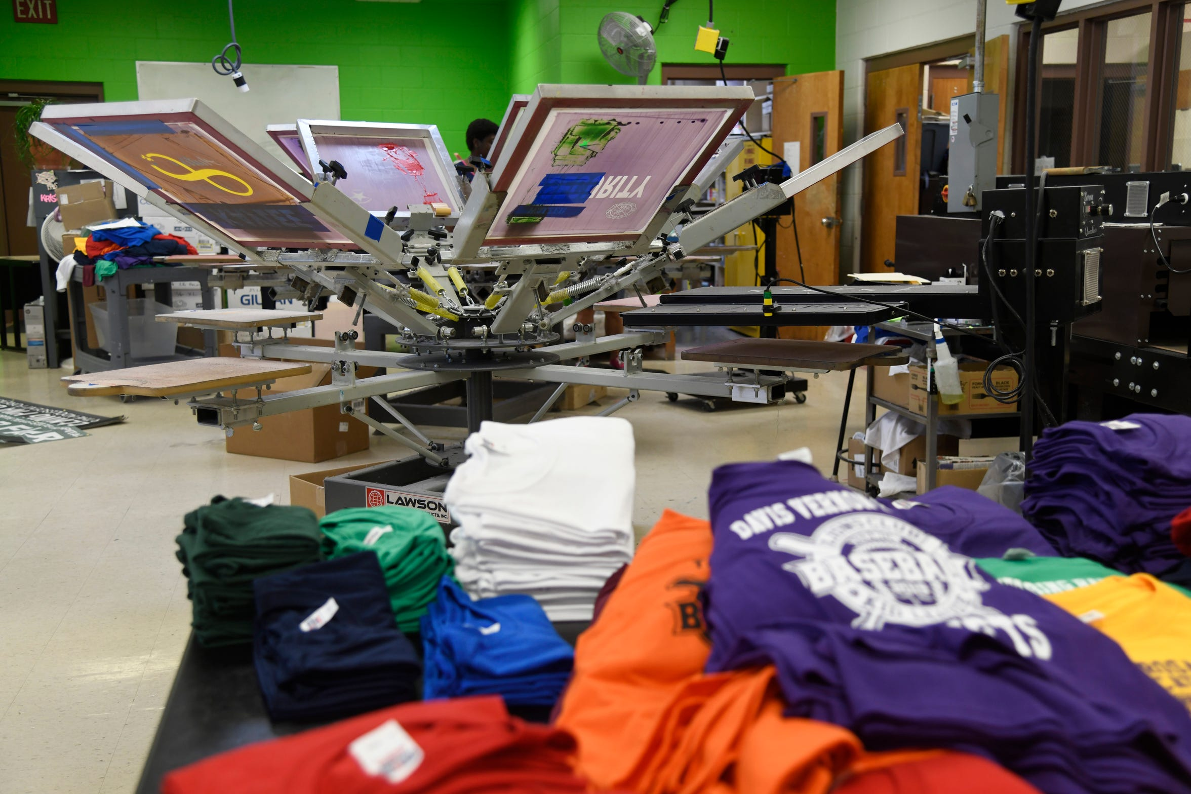 Screen-printed t-shirts sit in a workroom in the North Texas State Hospital, Monday, April 8, 2019, in Vernon, Texas. Patients are able to have jobs during their stay, like create t-shirts for local athletics.