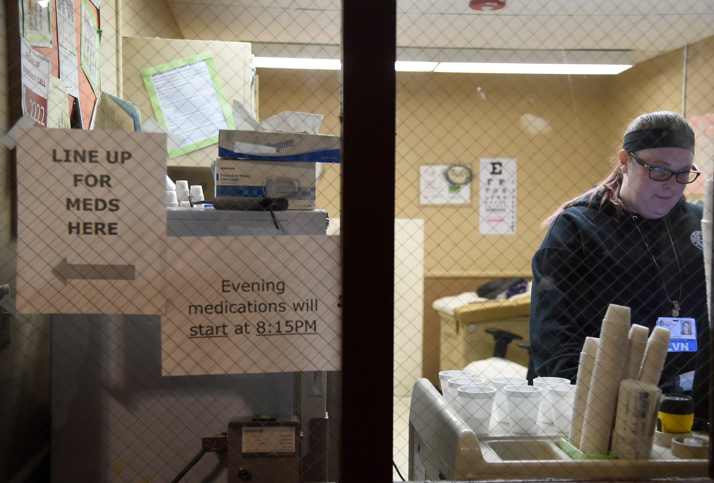 A North Texas State Hospital nurse prepares medication for patients, Monday, April 8, 2019, in Vernon, Texas.