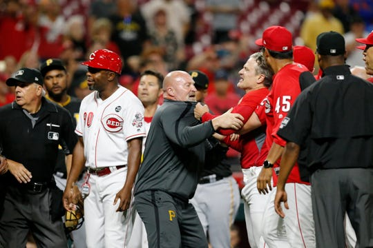 The Cincinnati Reds and Pittsburgh Pirates brawl in the ninth inning of the MLB National League game between the Cincinnati Reds and the Pittsburgh Pirates at Great American Ball Park in downtown Cincinnati on Tuesday, July 30, 2019. The Pirates won 11-4.