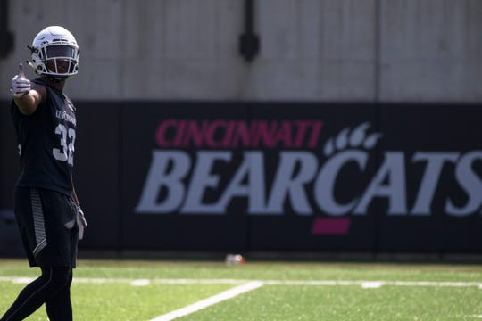 Cincinnati Bearcats safety James Wiggins (32) gives the thumbs during Cincinnati Bearcats football practice Wednesday, July 31, 2019, at the University of Cincinnati.