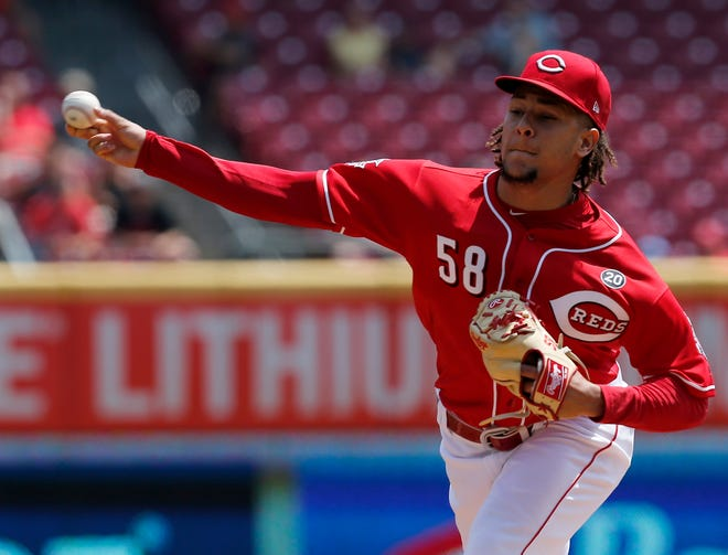 Cincinnati Reds starting pitcher Luis Castillo (58) delivers a pitch in the first inning of the MLB National League game between the Cincinnati Reds and the Pittsburgh Pirates at Great American Ball Park in downtown Cincinnati on Wednesday, July 31, 2019.