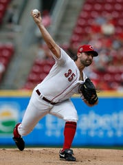 Cincinnati Reds starting pitcher Tanner Roark (35) delivers a pitch in the first inning of the MLB National League game between the Cincinnati Reds and the Pittsburgh Pirates at Great American Ball Park in downtown Cincinnati on Tuesday, July 30, 2019.